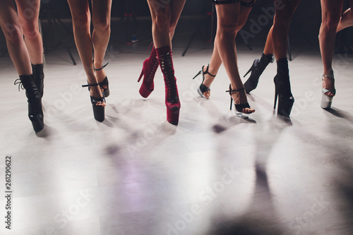 Canvastavla young striptease dancer moving in high heels shoes on stage in strip night club, Pole dancing