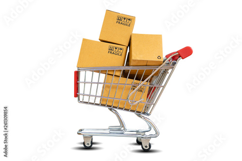 Fotografía Online Shopping and delivering concept - Shopping cart with product package boxe