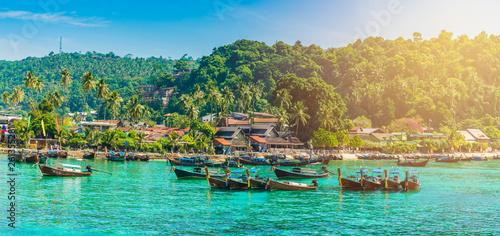 фотография Tonsai Beach bay with traditional longtail boats parking in Phi Phi island, Krab