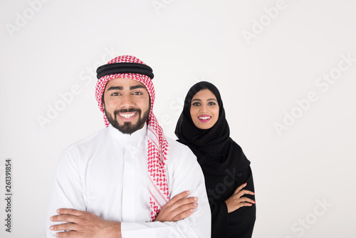 Tablou Canvas arab couple smiling and standing on white background