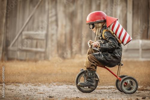 Fotografía Boy play in the rider and the rocketman