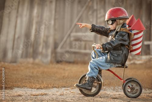 Obraz na plátně Boy play in the rider and the rocketman