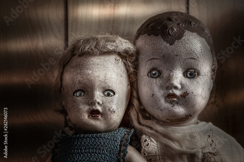 Canvas Scary old cracked dolls