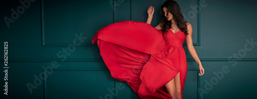 Fotografering Fashion lady in red maxi dress.