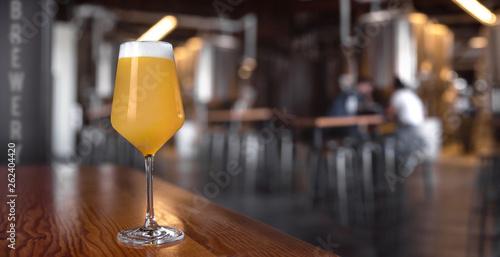 Платно Panoramic view of craft New England IPA beer at local brewery, hazy juicy ale