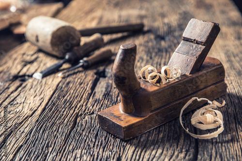 Billede på lærred Old planer and other vintage carpenter tools in a carpentry workshop