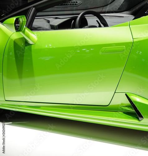фотография Shiny light green convertible sports car body door and rear view mirror