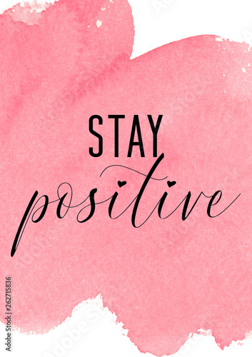 Fotografiet Stay positive. Inspiring quote with pink watercolor background