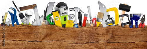 DIY handtools collage concept behind wooden wide panorama plank with copy space isolated white background