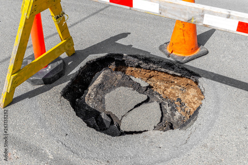 Fotografie, Obraz A large, deep pothole in a road