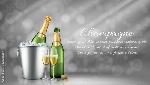 Fotografia Champagne bottle in ice bucket and two full glasses on grey blurred background with sun rays