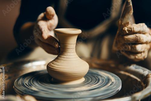 Slika na platnu Potter modeling ceramic pot from clay on a potter's wheel