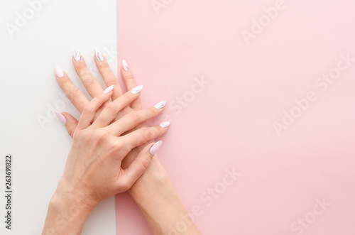 Valokuvatapetti Top view woman's hands manicure with nail painting work