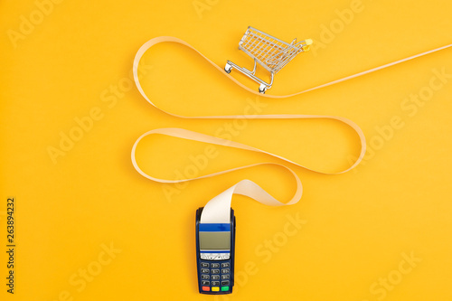 Shopping cart on a long POS terminal receipt Fototapeta