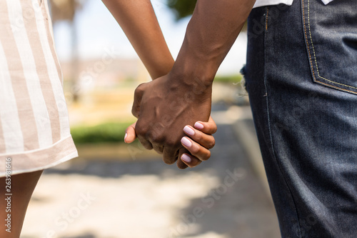 Canvas Print Close up outdoor protrait of black african american couple holding hands