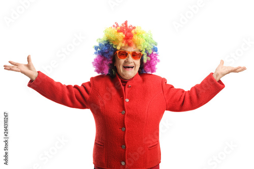 фотография Happy elderly lady with a red coat and a colorful wig