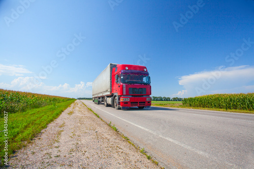 delivery truck outdoor on the highway ounder the blue cloudy sky  in Ukraine