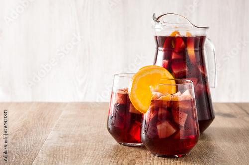 Obraz na płótnie Red wine sangria in glasses on wooden table. Copyspace