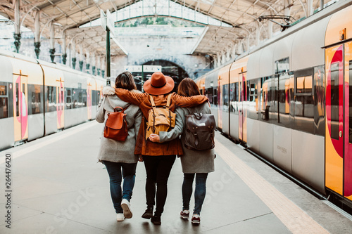 .A group of young friends waiting relaxed and carefree at the station in Porto, Portugal before catching a train. Travel photography. Lifestyle.