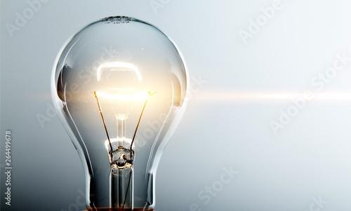 Tablou Canvas Glowing yellow light bulb, busienss idea concept