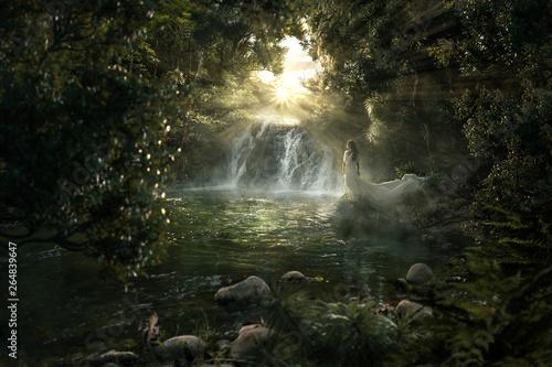 Obraz na plátně Frau steht an paradiesischem Wasserfall im Dschungel