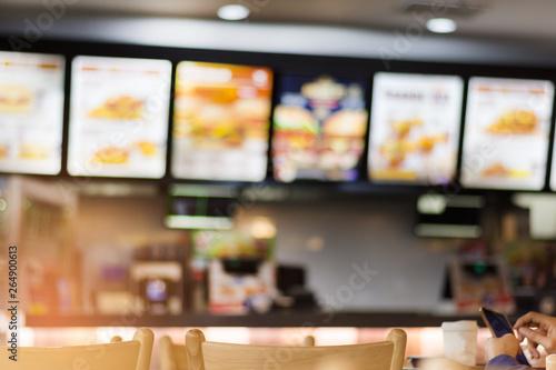 Obraz na plátně Blur image of fast food restaurant, use for defocused background.