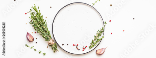 Fotografie, Obraz Empty plate with greens herbs and spices around