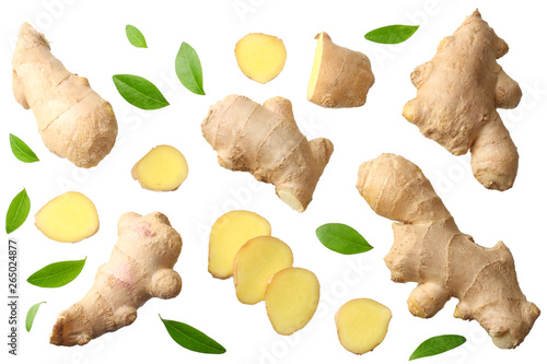 Fotografija sliced ginger with leaves isolated on white background top view