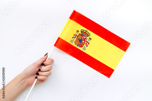 Wallpaper Mural Independence Day of Spain concept with flag in hand on white background top view