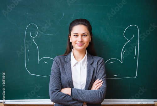 Fotografie, Obraz smiling teacher near the board
