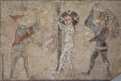 Jesus is whipped by two tormentors, beating him with their scourages Fototapeta