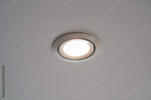 Stampa su Tela LED downlight or ceiling light Installed on a gray ceiling close up