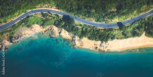 Obraz na płótnie Aerial view of the sandy beach and  road