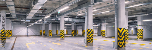 Canvas Print Empty shopping mall underground parking lot or garage interior with concrete str