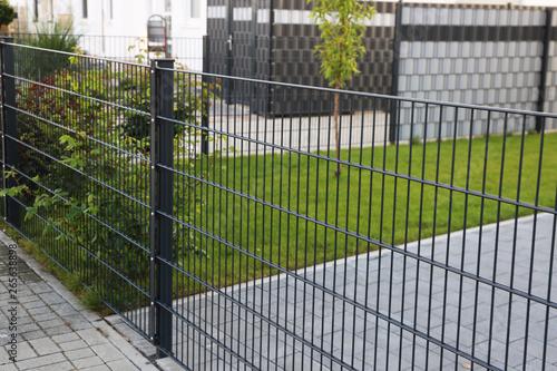 Obraz na plátně Green garden fence as property fence line