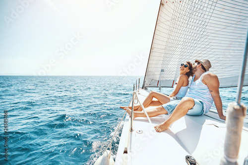 Fotografia Young man and woman Relaxing on a Yacht..