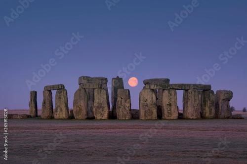 Fototapeta europe; UK, England, Wiltshire, Stonehenge winter moon