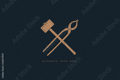 Hand drawn blacksmith tools on a dark background Fototapeta
