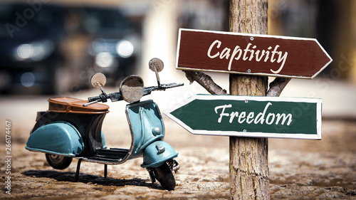 Valokuva Street Sign to Freedom versus Captivity