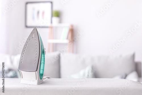 Fotografie, Obraz Modern iron on board in room