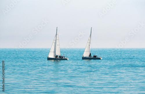 Fototapeta Sailing boats for regatta at blue sea and sky background