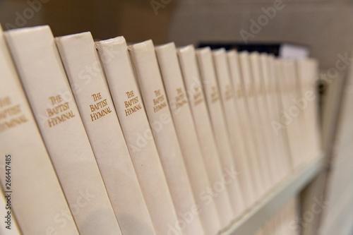 Obraz na płótnie Baptist Hymnal lined up on a shelf, shallow depth of field