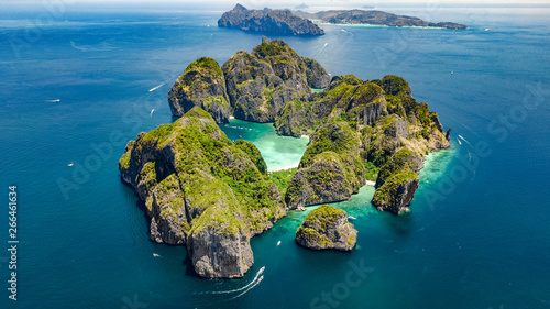 Платно Aerial drone view of tropical Ko Phi Phi island, beaches and boats in blue clear