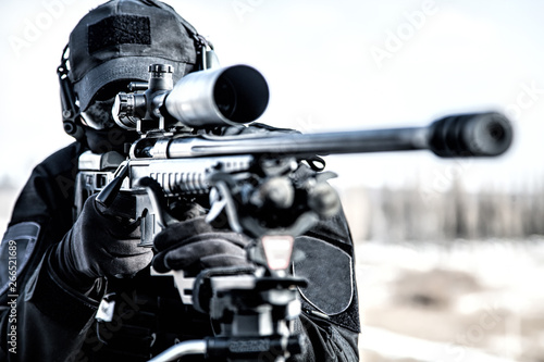 Fotografie, Obraz Equipped police SWAT sniper shooting with rifle