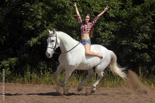 Fotografie, Obraz Young woman enjoy riding bareback on a galloping white horse