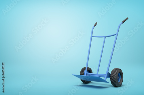 Leinwand Poster 3d rendering of blue empty hand truck standing upright in half-turn on light-blue background with much copy space
