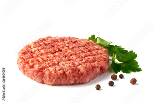 Fotografiet Raw beef patty with spices on white background