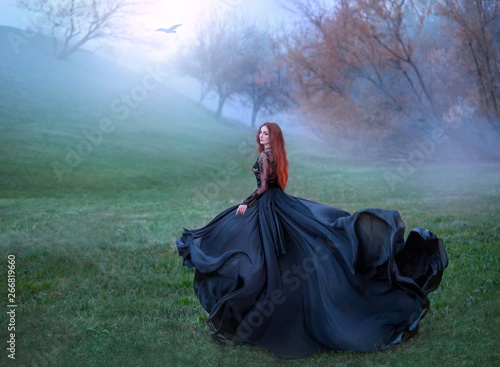 mysterious girl with red hair runs from forest in gorgeous lace royal dress with Fototapeta