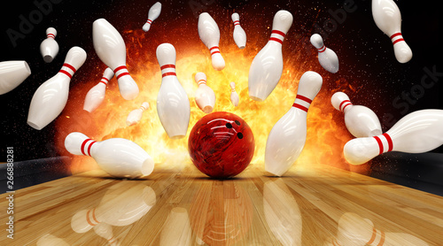 Foto Bowling strike hit with fire explosion