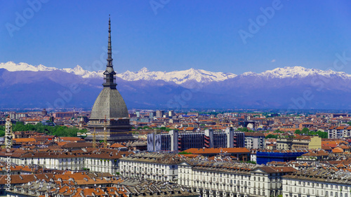 Fotografia Turin, Torino, aerial timelapse skyline panorama with Mole Antonelliana, Monte dei Cappuccini and the Alps in the background